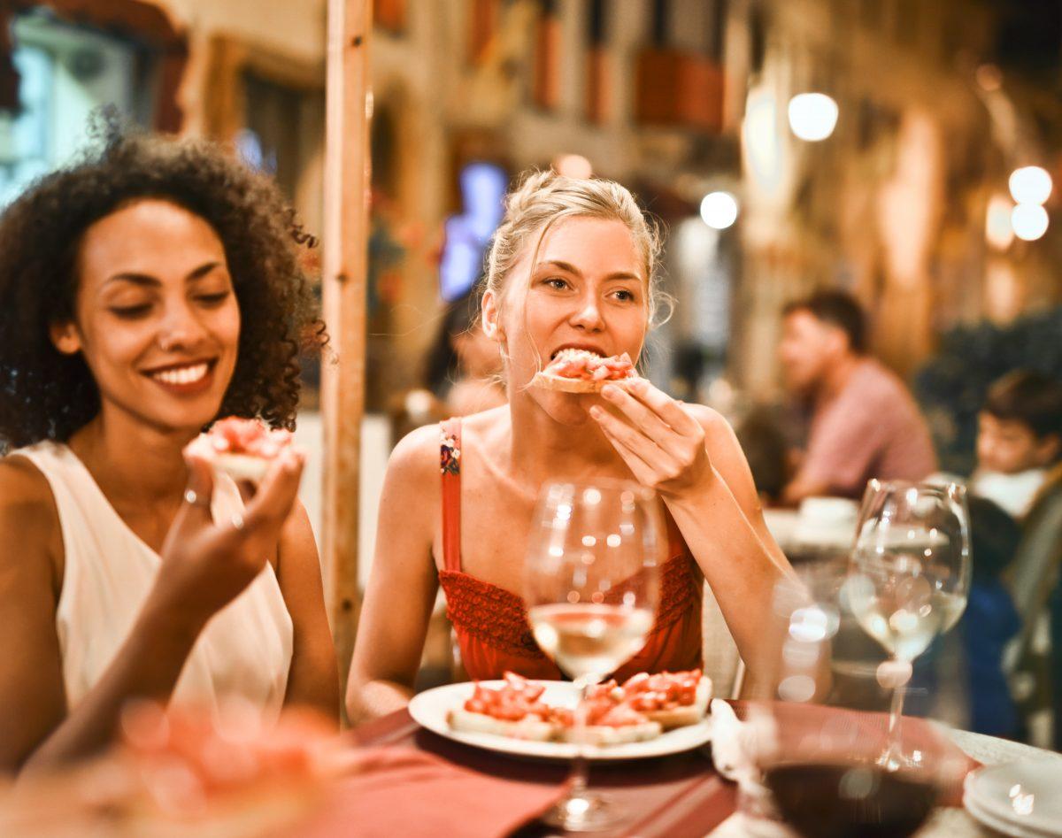 woman-eating-bruschetta-1537635